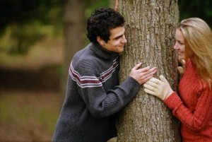Couple Standing Around a Tree