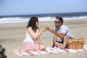 Man and woman having a picnic on the beach