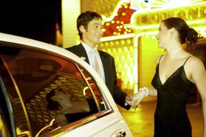 Man opening car door for woman