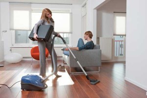 Woman cleaning house for her husband