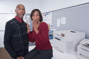 Man and woman surprised at work