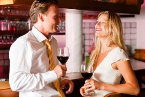 Man and woman on date talking at a bar