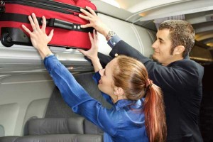 Man helping woman with her luggage