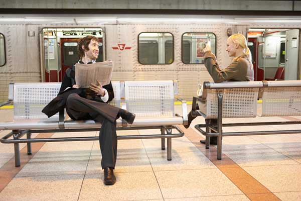 Man and woman waiting in subway station