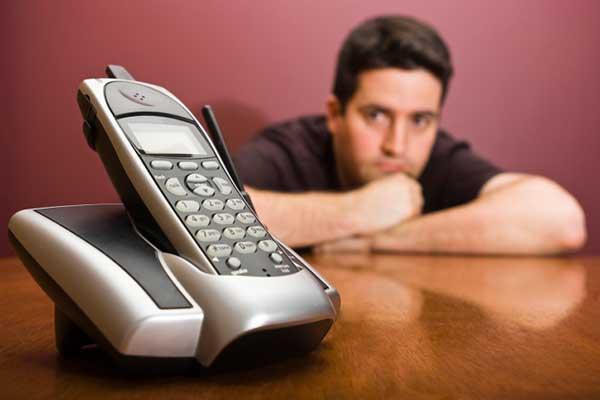 Man staring at phone waiting