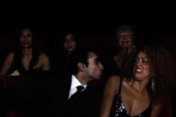 Woman rejecting man's kiss